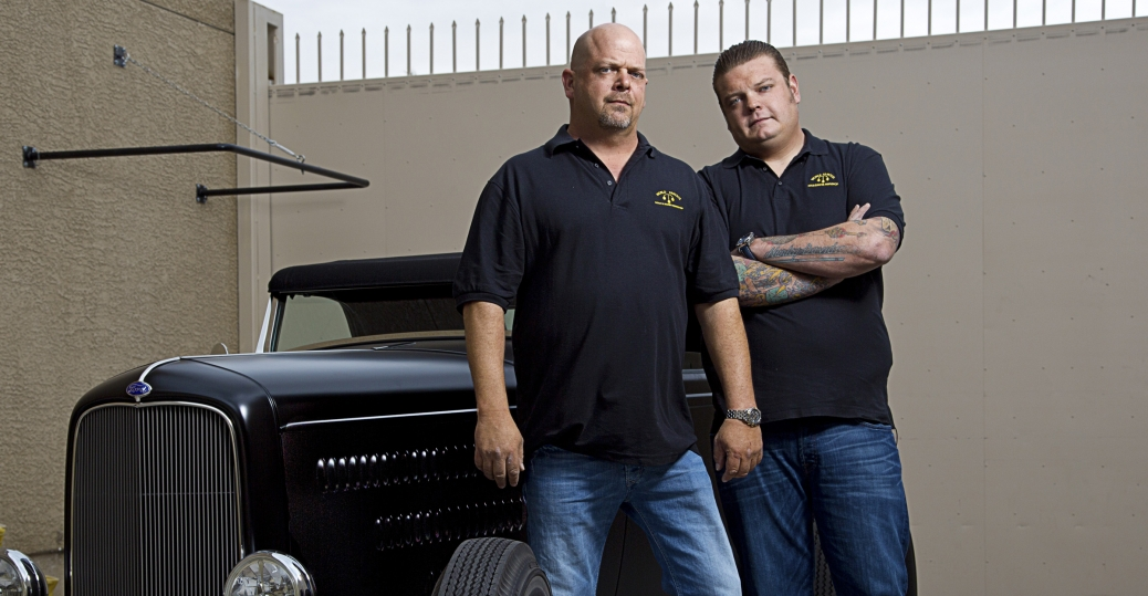 "Rick Harrison and Corey ""Big Hoss"" Harrison behind the shop with an"