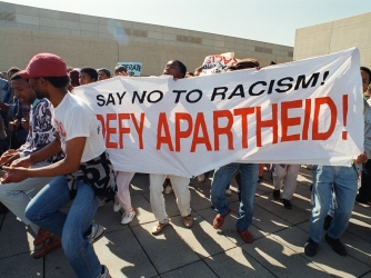 South america and Apartheid, how did it end? please help!!!?
