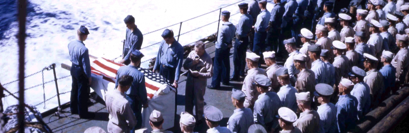 A burial at sea ceremonies aboard the USS Hansford (APA-106) during the invasion of Iwo Jima