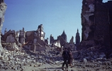 Locals walking through ruins of the heavily bombed city.