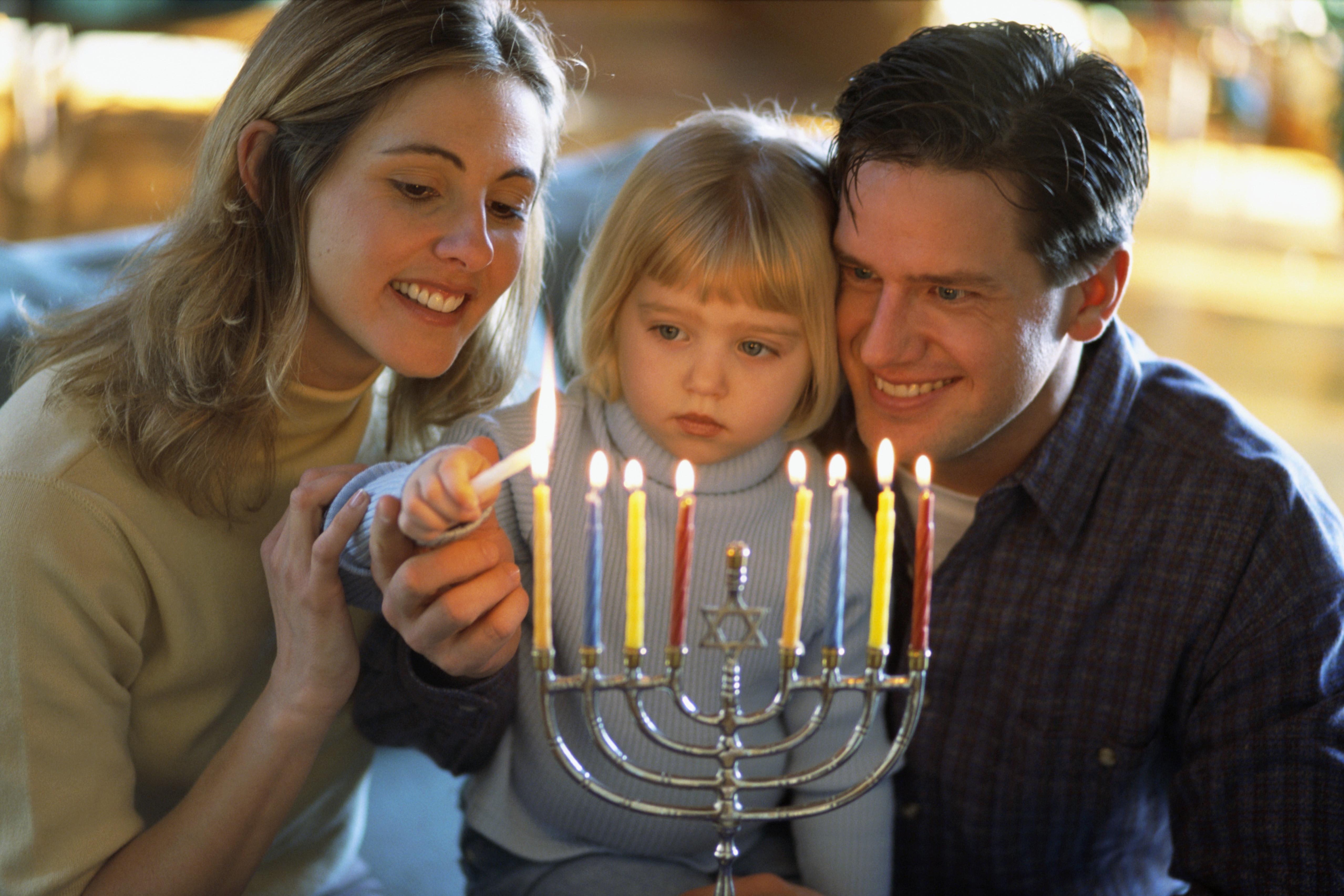 hanukkah menorah eight nights of hanukkah candles shammash holidays jewish  sc 1 th 183 & family-lighting-menorah-2 - Hanukkah Pictures - Hanukkah - HISTORY.com azcodes.com