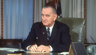 LBJ at his desk in the Oval Office.