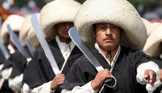Participants appear in costume at a Cinco de Mayo parade in Puebla, Mexico.