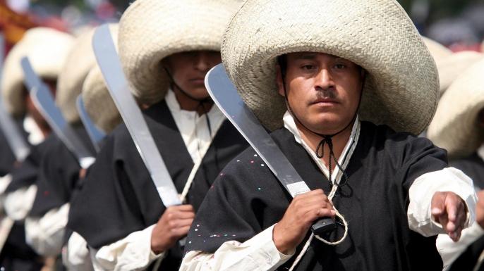 Participants appear in costume at a Cinco de Mayo parade in Puebla, Mexico.