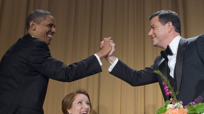 President Barack Obama congratulates host Jimmy Kimmel at the 2012 White House Correspondents' Association Dinner as WHCA chief Caren Bohan looks on