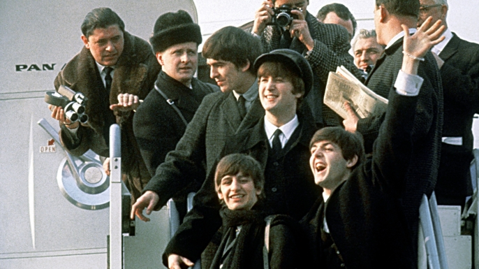 The Beatles arrive at New York's JFK airport on February 7, 1964.