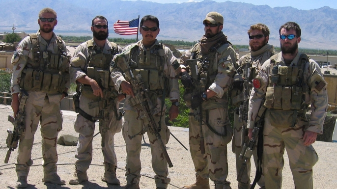 Matthew G. Axelson, Daniel R. Healy, James Suh, Marcus Luttrell, Eric S. Patton and Michael P. Murphy pose in Afghanistan on June 18, 2005. Ten days later, all but Luttrell would be killed by enemy forces while supporting Operating Red Wings, which also claimed the lives of Danny Dietz and 13 other Navy Seals.