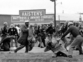 Alabama state troopers assault civil rights voting marchers, including John Lewis. (Credit: AP Photo/File)