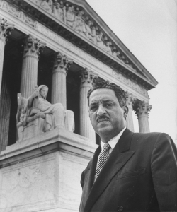 NAACP chief counsel Thurgood Marshall outside the Supreme Court . (Credit: Hank Walker//Time Life Pictures/Getty Images)