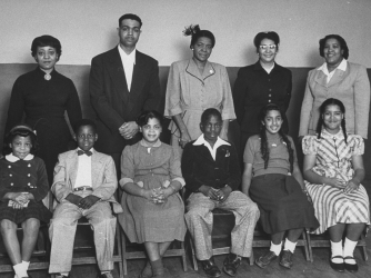 The plaintiffs in the landmark Brown v. Board of Education case and their children: (front row) Vicki Henderson, Donald Henderson, Linda Brown, James Emanuel, Nancy Todd, and Katherine Carper; (back row) Zelma Henderson, Oliver Brown, Sadie Emanuel, Lucinda Todd, & Lena Carper. (Credit: Carl Iwasaki/Time Life Pictures/Getty Images)