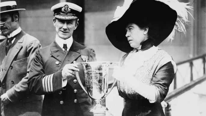 Arthur Rostron, captain of Carpathia, receives a trophy from Titanic survivor Molly Brown in May 1912.