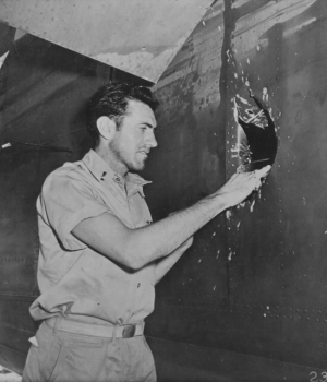 Zamperini inspects his damaged B-24 bomber