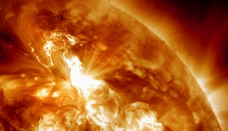 A solar flare erupts on January 22, 2012.