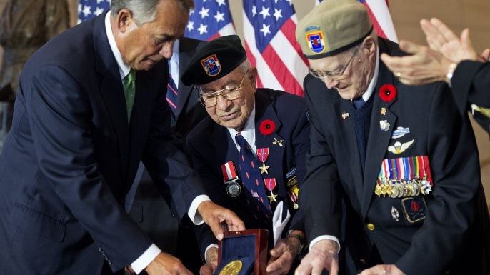 Speaker John Boehner presents the Congressional Gold Medal to American Eugene Gutierrez and Canadian Charles Mann, members of the 1st Special Service Force.