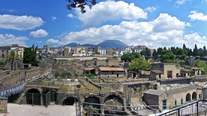 Excavated homes in the ancient Roman city of Herculaneum, with the modern town of Ercolano visible in the background.