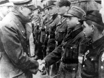 Hitler awards the Iron Cross to members of the Hitler Youth on April 20, 1945.