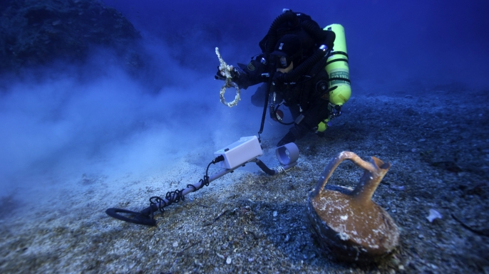 A technical diver examines the Antikythera shipwreck