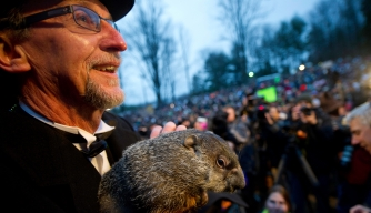 A groundhog handler holds Punxsutawney Phil after his 2012 weather prediction in Punxsutawney, Pennsylvania.