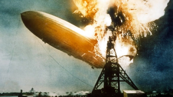 The Hindenburg bursts into blames above Lakehurst, New Jersey, on May 6, 1937.