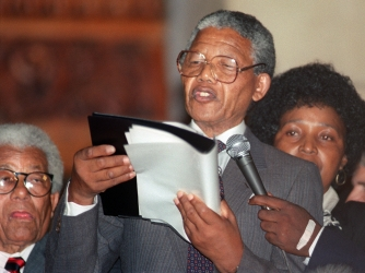 Mandela delivers his first speech following his release on February 11, 1990. (Credit: Walter Dhladhla/AFP/Getty Images)