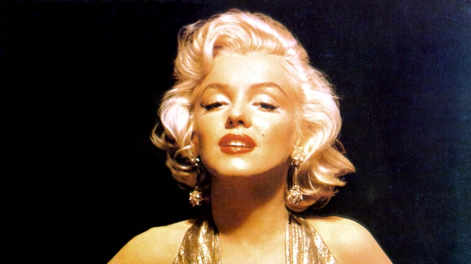 Marilyn Monroe appears in one of her most iconic portraits several years before singing at President Kennedy's birthday gala.