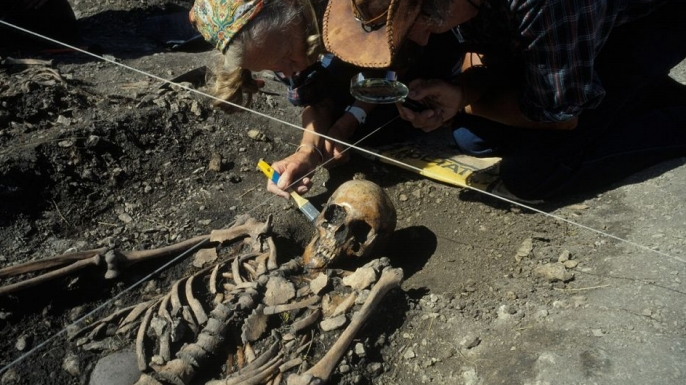 Researchers excavate a hunter-gatherer burial site in Gotland, Sweden.