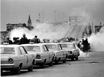 State troopers break up the demonstration on Pettus Bridge. (Credit: AP Photo/File)