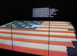 The garrison flag that was raised over Fort McHenry, on display at the Smithsonian's National Museum of American History.