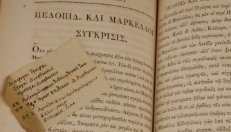 "A scrap of paper with Greek notes in Jefferson's handwriting tucked in a volume of Plutarch's ""Lives."""