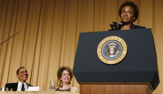 President Barack Obama and journalist Jennifer Loven listen to comedian Wanda Sykes at the White House Correspondents' Dinner in 2011.