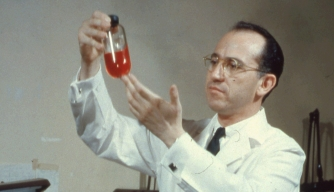 Jonas Salk in his lab,