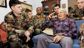 Bataan Death March survivor Albert Brown, who died last weekend at 105, speaks with ROTC members in 2005.