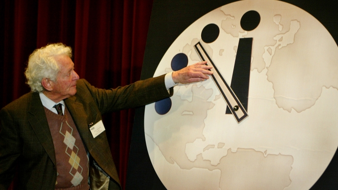 Physicist Leon Lederman moves the hands of the Doomsday Clock two minutes closer to midnight on February 27, 2002.