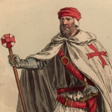 A soldier wearing the uniform of the order of the Knights Templar.