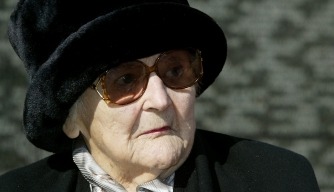 World War II resistance fighter Nancy Wake sits in front of the Australian war memorial in London in 2004.