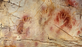Handprints at the El Castillo cave in Spain, where paintings have been dated to as far back as 40,800 years ago.