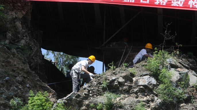 Chinese archaeologists excavate the Peking Man site at the Zhoukoudian caves in 2009
