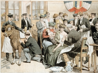Painting depicting a free smallpox vaccination clinic in France, c. 1905. (Credit: Ann Ronan Pictures/Print Collector/Getty Images)