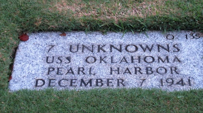 Gravestone identifying it as the resting place of seven unknowns from USS Oklahoma.
