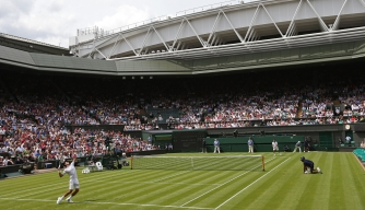 Defending champion Novak Djokovic plays against Juan Carlos Ferrero on the first day of the 2012 Wimbledon Championships