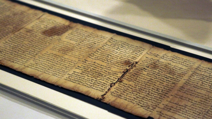 A part of the Isaiah Scroll, one of the Dead Sea Scrolls, is seen inside the vault of the Shrine of the Book building at the Israel Museum. (Credit: Lior Mizrahi/Getty Images)