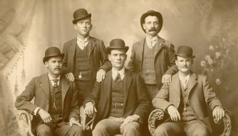The Wild Bunch in 1901, with Henry Longabaugh (Sundance Kid) sitting far left and Robert LeRoy Parker (Butch Cassidy) sitting far right.
