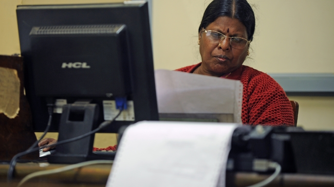 An employee monitors an incoming telegram at a telecommunications office in Bangalore, India.