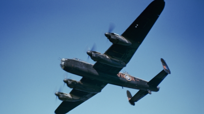 A Lancaster bomber, similar to the plane that crashed in Germany in April 1943, flies in England in September 2012.