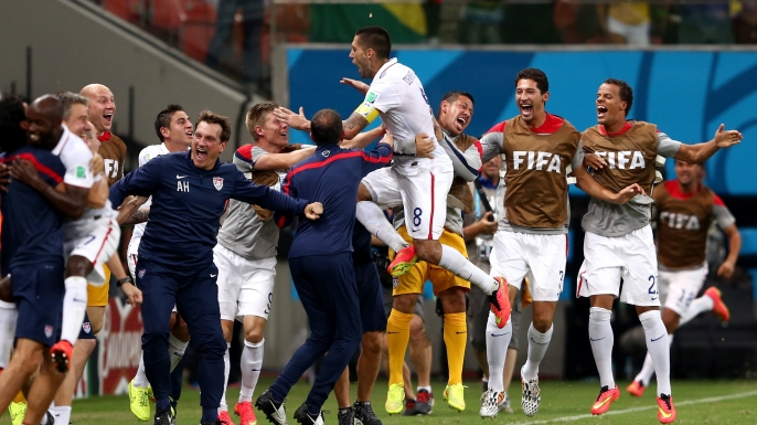 Clint Dempsey and teammates celebrate Dempsey's goal in a group match tie between the United States and Portugal at the 2014 FIFA World Cup Brazil.