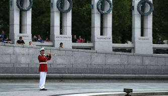 A wreath is laid during a a V-E Day ceremony at the World War II Memorial, May 8, 2013.