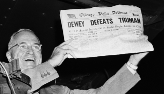 President Harry Truman holds up a copy of the Chicago Daily Tribune declaring his defeat to Thomas Dewey.