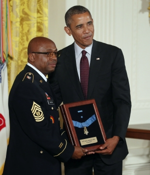 President Barack Obama presents a Medal of Honor to Command Sergeant Major Louis Wilson of the New York National Guard, who is accepting on behalf of the late Army Private Henry Johnson. (Credit: Mark Wilson/Getty Images)