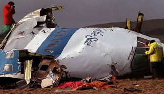 Investigators examine the wreckage of Pan Am Flight 103.