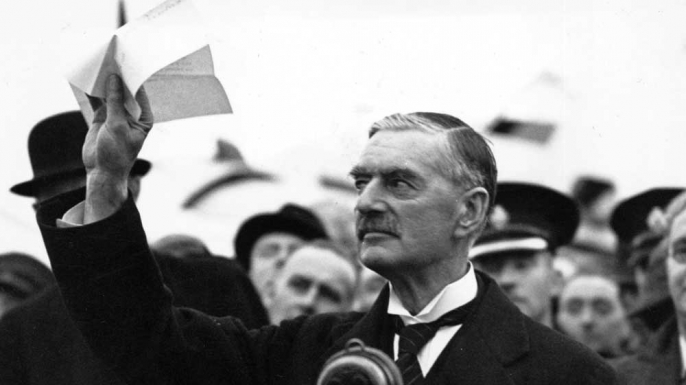 Prime Minister Neville Chamberlain upon his return to London on September 30, 1938.